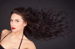 волосы брюнет ее женщина движения Стоковые Изображения