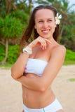 волосы цветка ее симпатичная женщина smiley Стоковое фото RF