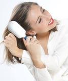 волосы девушки щетки их которые Стоковая Фотография RF