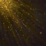 Волшебная золотая искра на темной предпосылке стоковое фото rf