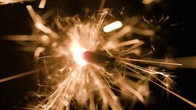 Волшебная накаляя подача искр в темноте Стоковое Изображение RF