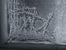 Волшебные снежинки на окне Стоковые Фото
