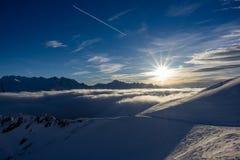 Волшебный заход солнца над облаками Стоковое Фото