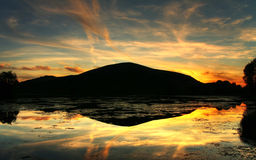 волшебный заход солнца отражения Стоковое фото RF