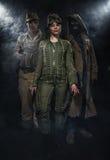 2 вооруженных люд и одна женщина Стоковая Фотография