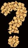 Вопросительный знак состоя из печений изолированных на черной предпосылке Стоковая Фотография