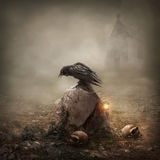 Ворона на могильном камне