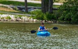 Воссоздание сплавляться на озере Стоковое Изображение