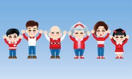 Восточная семья с костюмом зимы и обеими руками подняла стоковое фото