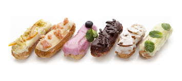 восхитительные eclairs cream десерта Стоковое фото RF