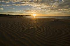 Восход солнца над пляжем Petreborough Стоковое Изображение
