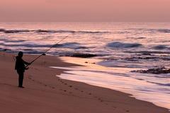 восход солнца рыболова Стоковые Фото