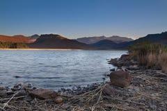 восход солнца рыболовства запруды Стоковая Фотография