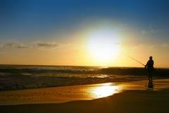восход солнца рыболовства пляжа Стоковое Изображение RF