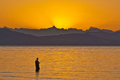 восход солнца рыболовства Стоковая Фотография