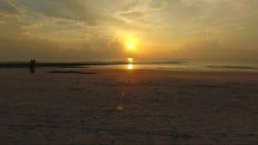 Восход солнца с черным камнем сток-видео