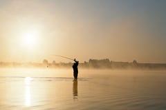 восход солнца человека рыболовства Стоковая Фотография