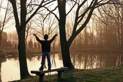 восход солнца мальчика Стоковые Изображения