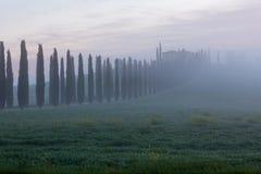 восход солнца Тоскана сельского дома Стоковая Фотография