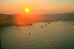 Восход солнца, гавань Валлетты, Мальта Стоковая Фотография RF