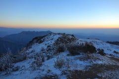 Восход солнца горы снега Стоковое фото RF