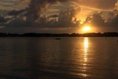 Восход солнца между облаками Стоковая Фотография RF