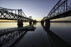 Восход солнца моста Dandong Рекы Ялуцзян Стоковое фото RF