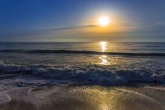 Восход солнца над морем Стоковые Изображения