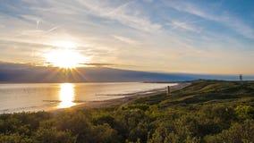 Восход солнца на море, съемка от dike Стоковые Изображения RF