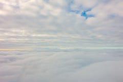 Восход солнца над облаками от окна самолета Стоковое фото RF