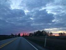 Восход солнца на дороге Стоковые Изображения