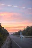 Восход солнца на дороге стоковая фотография