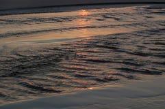 Восход солнца на прибое Стоковые Изображения