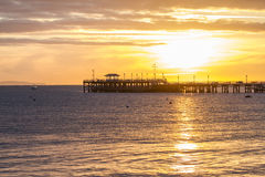 Восход солнца над пристанью в заливе Стоковое Изображение RF