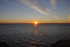 Восход солнца на пляже над морем Стоковые Изображения RF