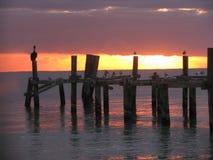 Восход солнца на старой пристани Стоковые Изображения