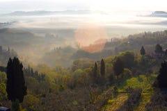 Восход солнца над tuscanian холмами Стоковое Изображение RF