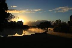 Восход солнца среди тумана Стоковые Изображения RF