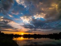 Восход солнца с облачным небом Стоковое Изображение