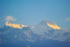 Восход солнца утра гор снега Стоковые Фото
