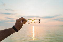 Восход солнца через eyeglasses Стоковое Фото