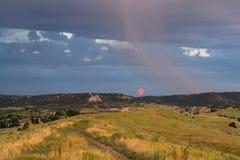 Восход луны и осадки Стоковые Изображения