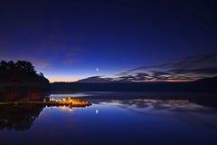 Восход луны над доком Стоковое Изображение