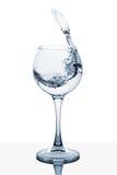 Вода брызгая из высокорослого стекла Стоковая Фотография RF