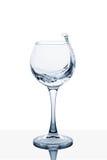 Вода брызгая из высокорослого стекла Стоковое фото RF