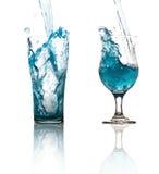 Вода брызгая от изолированного стекла Стоковые Изображения