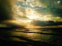 Вода захода солнца стоковые изображения