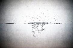 вода пузырей ванны предпосылки голубая стоковое изображение
