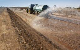 Вода трактора распространяя Стоковое фото RF