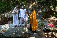 Во время христианского таинства духовного рождения - крещения Стоковые Фотографии RF